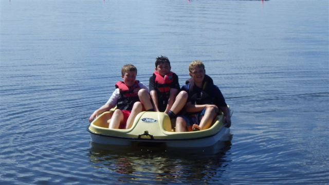 kid's in a peddle boat
